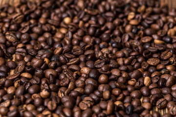 fried coffee beans. coffee beans, on a wooden background