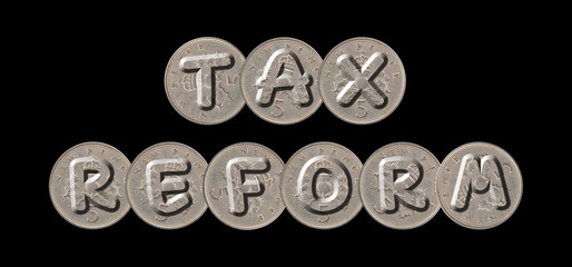 TAX REFORM – Coins on black background