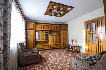Interior of luxury room with expensive hand made wooden furniture