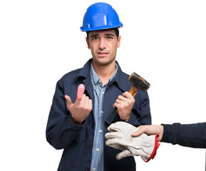 Worker suffering from an hammer blow on his finger. Isolated on white