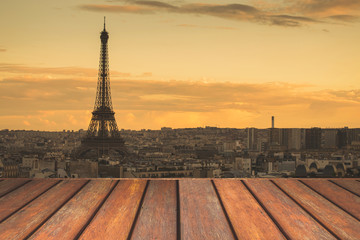Empty wooden floor and Eiffel tower landscape view on sunset.