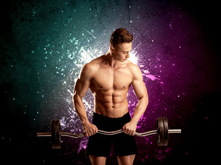 Attractive musculous guy lifting weight