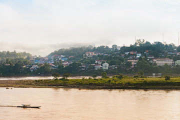 View of local boat transport on Mae Khong river from Chiang Khong city in the morning.