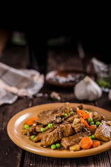 Pork medallions with vegetable and soy garlic sauce