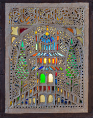 Perforated stucco window decorated with colorful stain glass with floral patterns, one of the traditions of the Ottoman era