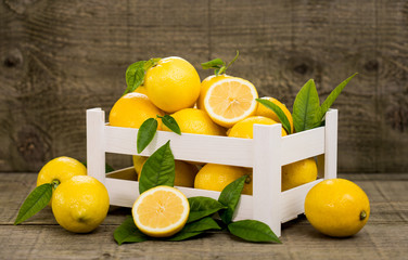 Fresh lemons in the crate