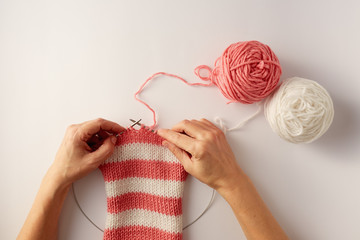 Knitting stripes with two colors of yarn.