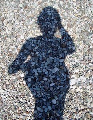 female shadow on the beach