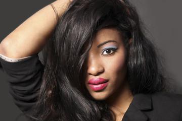 beautiful African American,cuban girl fashion model dancer posing in studio