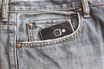 Close up of smartphone in pocket on jeans