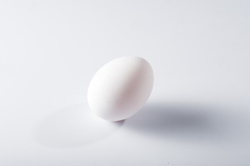 White egg with shadow isolated on white background