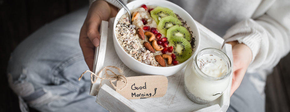 healthy breakfast at the girl in hands, concept of healthy food