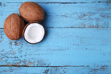 Coconuts on blue wooden table