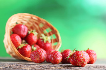 Fresh strawberries on grey wooden table