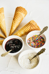 ice cream cones and fillers for ice-cream on a white background, topping, jam and culinary topping