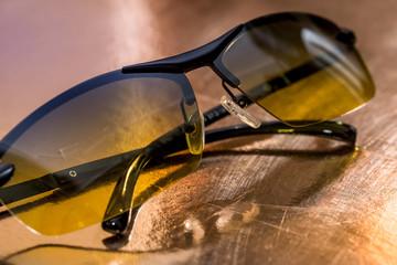 eyeglasses isolated on gold. close up