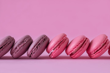 Pink and purple macaroons on pink