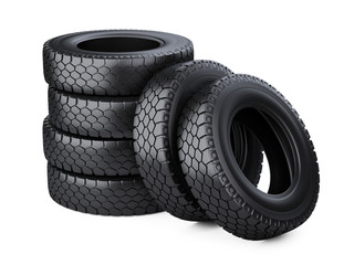 Set of six big vehicle truck tires stacked.