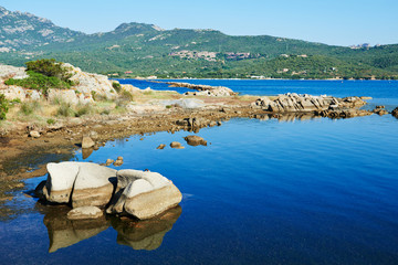 Blue meditteranean sea with stone sardinia shore