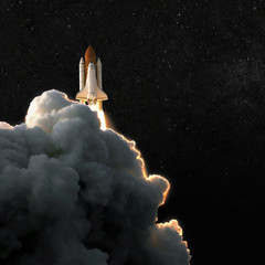 Spaceship rocket and starry sky. spacecraft flies into space with clouds of smoke