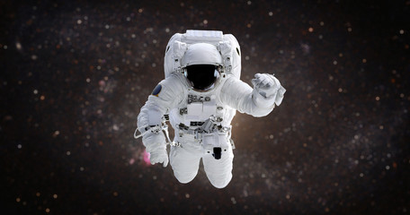 Spaceman. Astronaut in the open space against the background of the galaxy