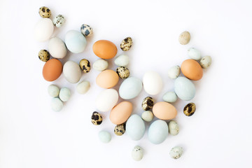 Composition of colorful Easter eggs on white background.