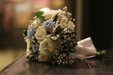 Wedding Accessories. Bridal bouquet and champagne glasses.