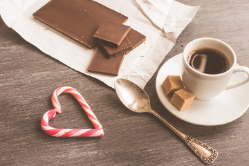 A cup of coffee, chocolate and a heart from Lolypop