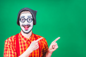 cheerful mime posing near a green background Wall mural