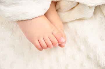 Tiny toes in bed
