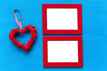 Red frame and heart on the table.