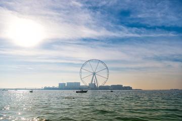 Ferris wheel in Dubai, United Arab Emirates, from blue sea