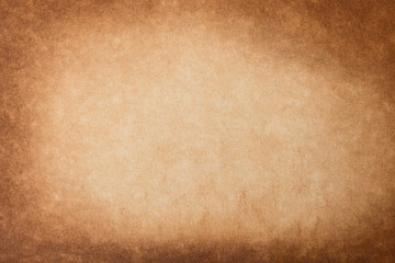 Vintage old grunge background texture paper. Brown burnt paper background