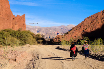 Bolivian people along dirt road,Bolivia