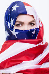 beautiful Sirian woman wearing a hijab from the American flag