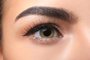 Young woman with beautiful eyebrow, closeup