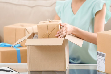 Woman with parcel at home