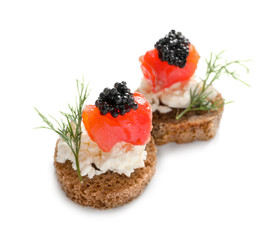 Delicious canapes with black caviar on white background