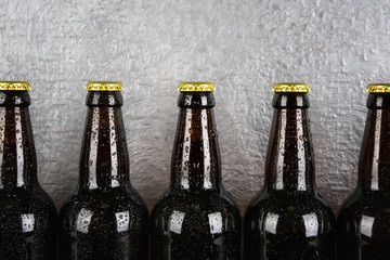 Bottles of beer on textured background