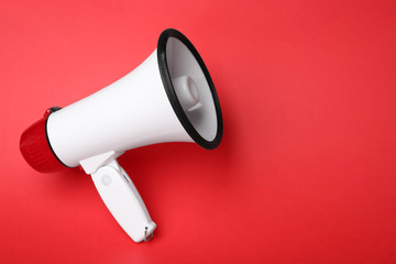 Electronic megaphone on color background Wall mural