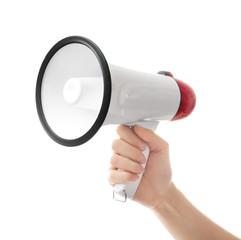 Woman holding electronic megaphone on white background