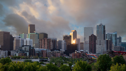 Close of the Denver Colorado skyline with morning clouds in the sky