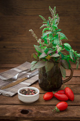 Herbs, spices and tomatoes on dark background. Vegetarian concept. Wooden rustic background. Top view