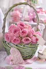 romantic bunch of pink roses in wicker basket