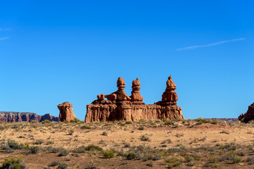 Isolated line of hoodoos, near the entrance to the valley, Goblin Valley State Park, Utah,