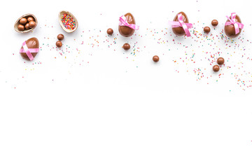 Chocolate Easter eggs as little gift. White background top view copy space