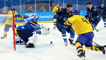 Olympics: Ice Hockey-Men Team Group C - SWE-FIN
