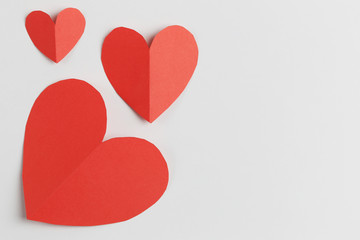 Red paper of heart shape isolated on white background.
