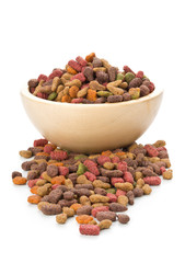 Heap of dry pet food in wooden bowl