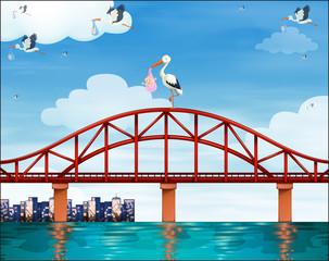 Baby and crane on the bridge